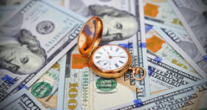 Money and antique gold pocket watch
